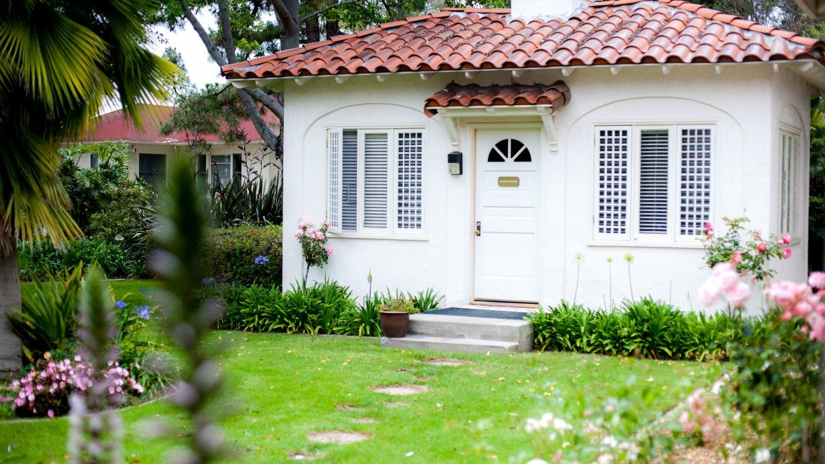PLNU's alumni guest cottage features a stone walkway and green grass all around