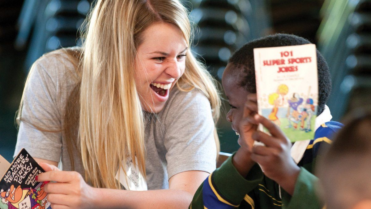 A PLNU student tutors a child through Alima Tutoring Ministry.