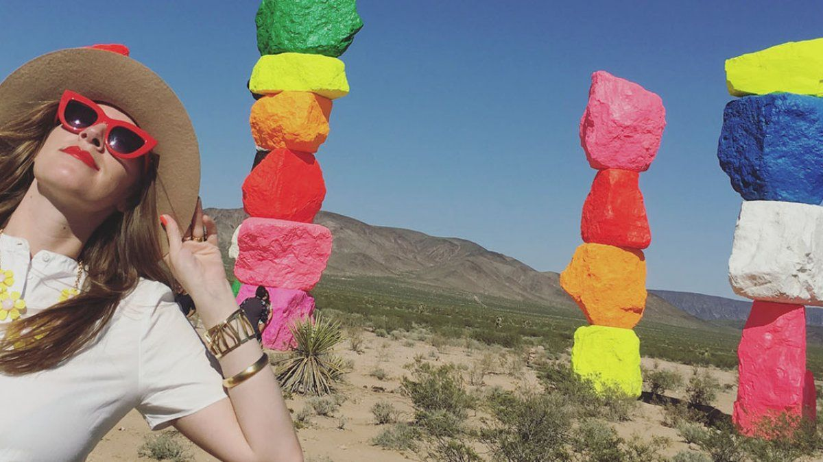 Channin Fulton in the desert next to Seven Magic Mountains, by Swiss artist Ugo Rondinone.