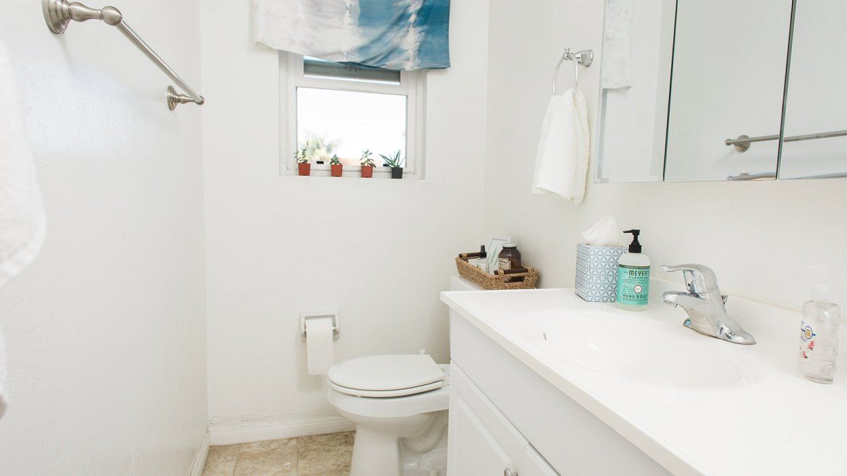 A two-person colony bathroom neatly organized and cleaned.