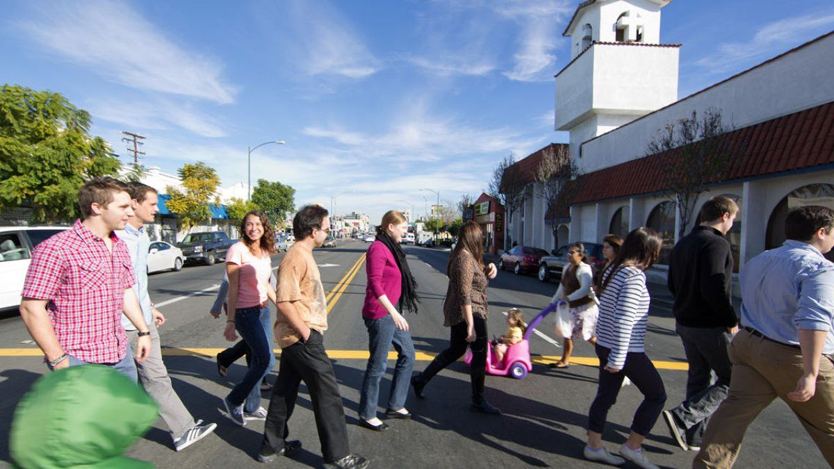 Students and teacher cross street in City Heights