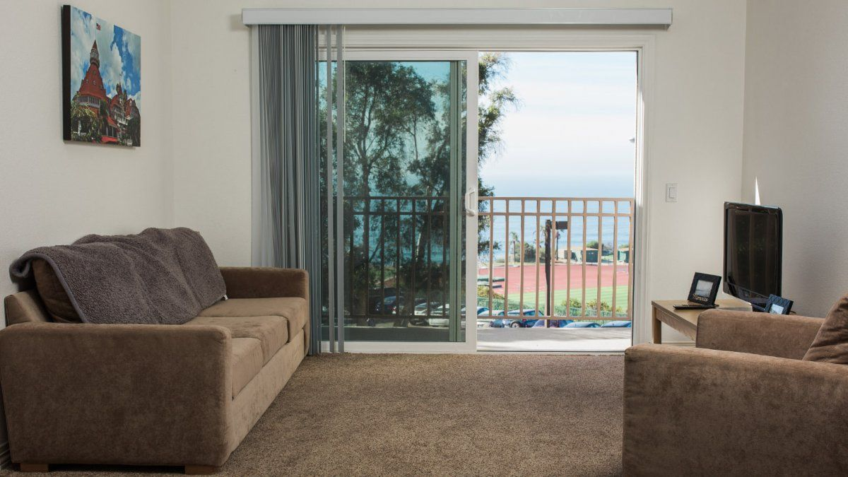 A living room in the Flex Apartments, complete with sofas and an ocean view.