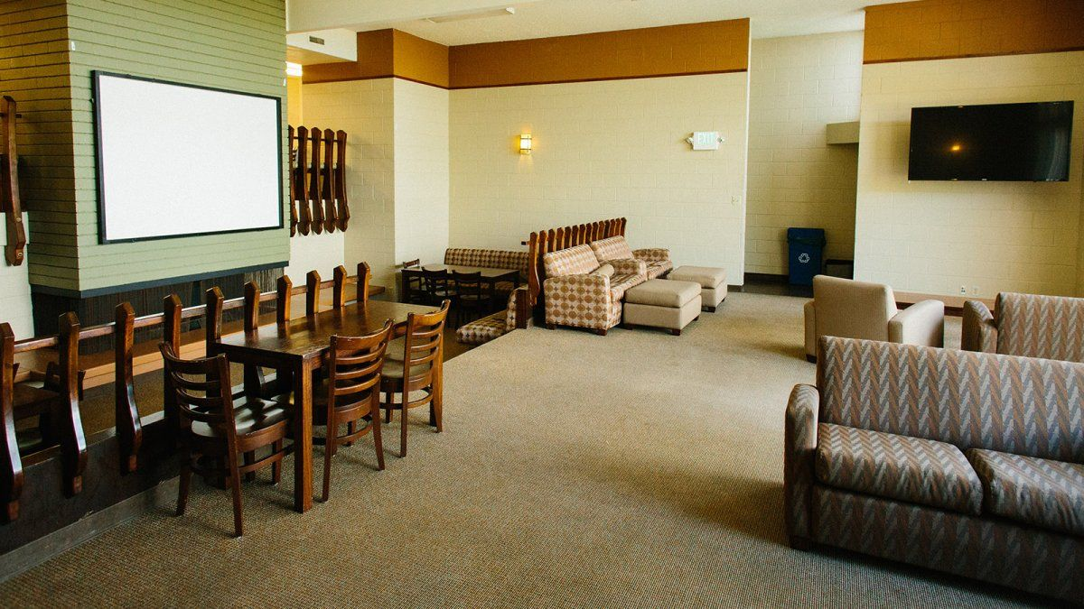 Couches, chairs, and a soft carpeted floor make up the Goodwin Lounge.