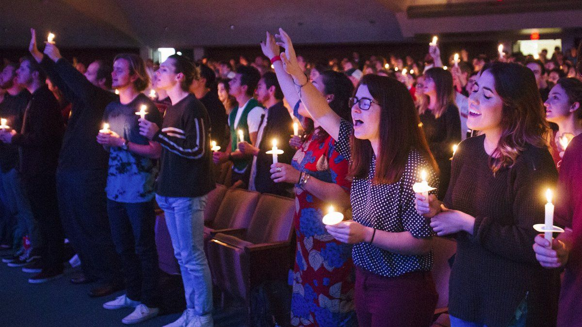 Students worship during a candlelight service in Brown Chapel.