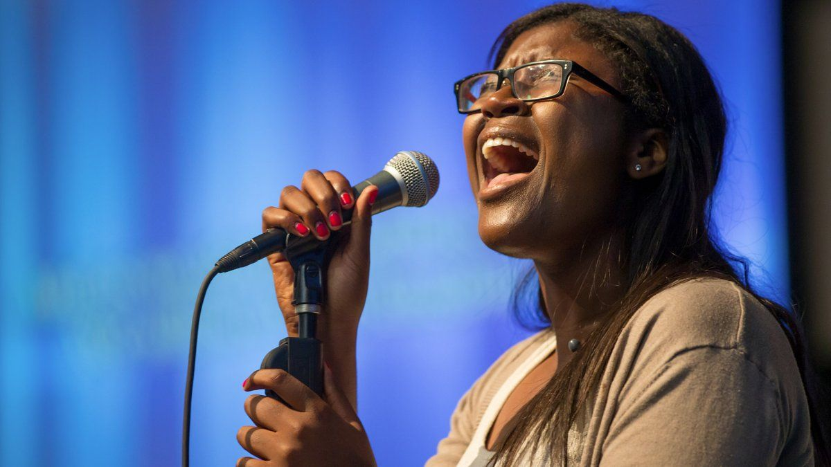 MBA student, Victoria Sibingo, passionately singing at chapel.