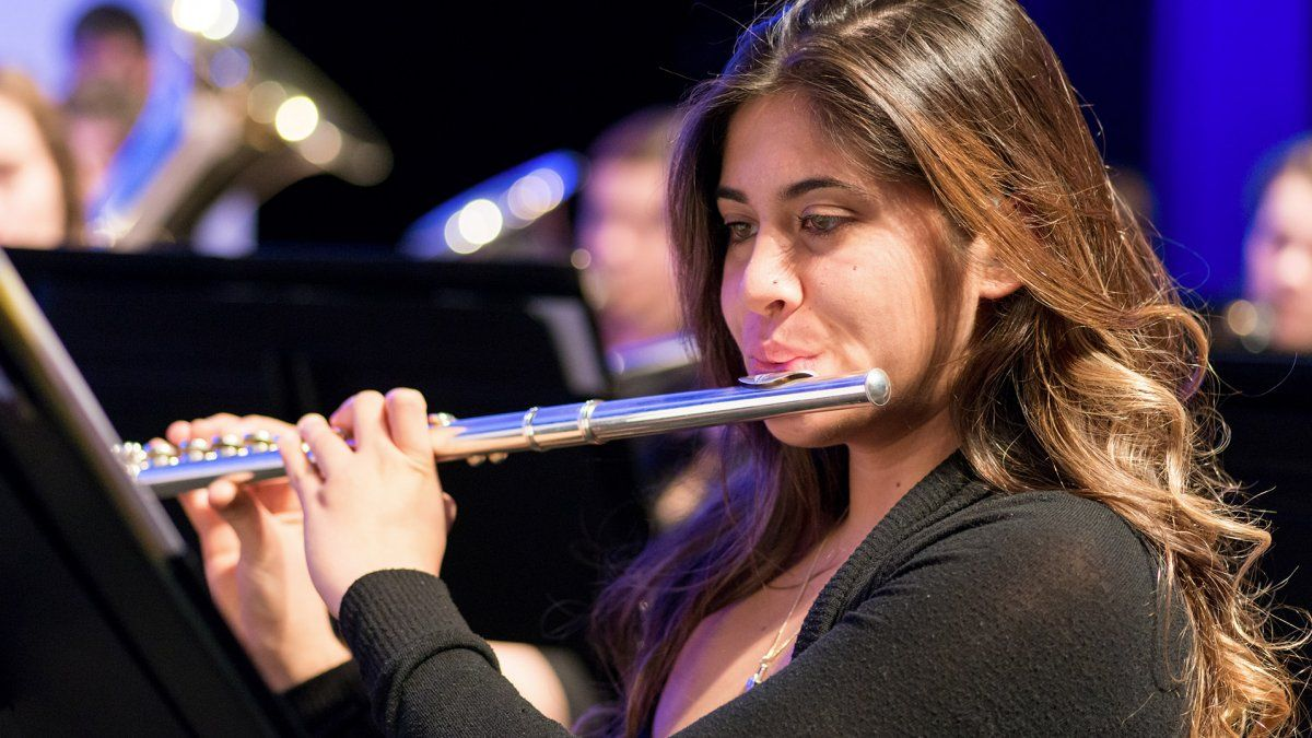 A student plays the flute