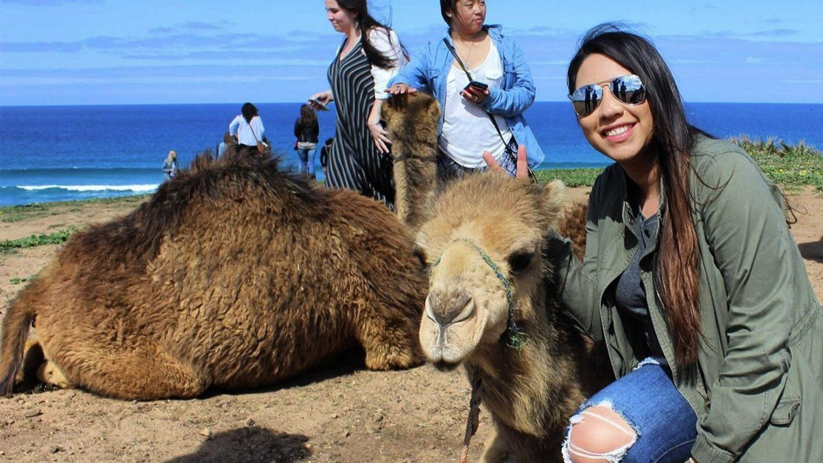 PLNU student Leslie Portillo poses next to a camel in Morocco.