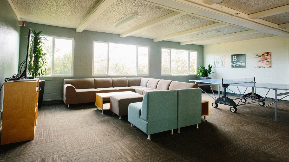 Large sofas and a ping pong table make up the Wiley downstairs lounge space.