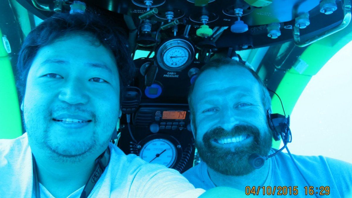 Walter Cho and a colleague in an underwater submarine