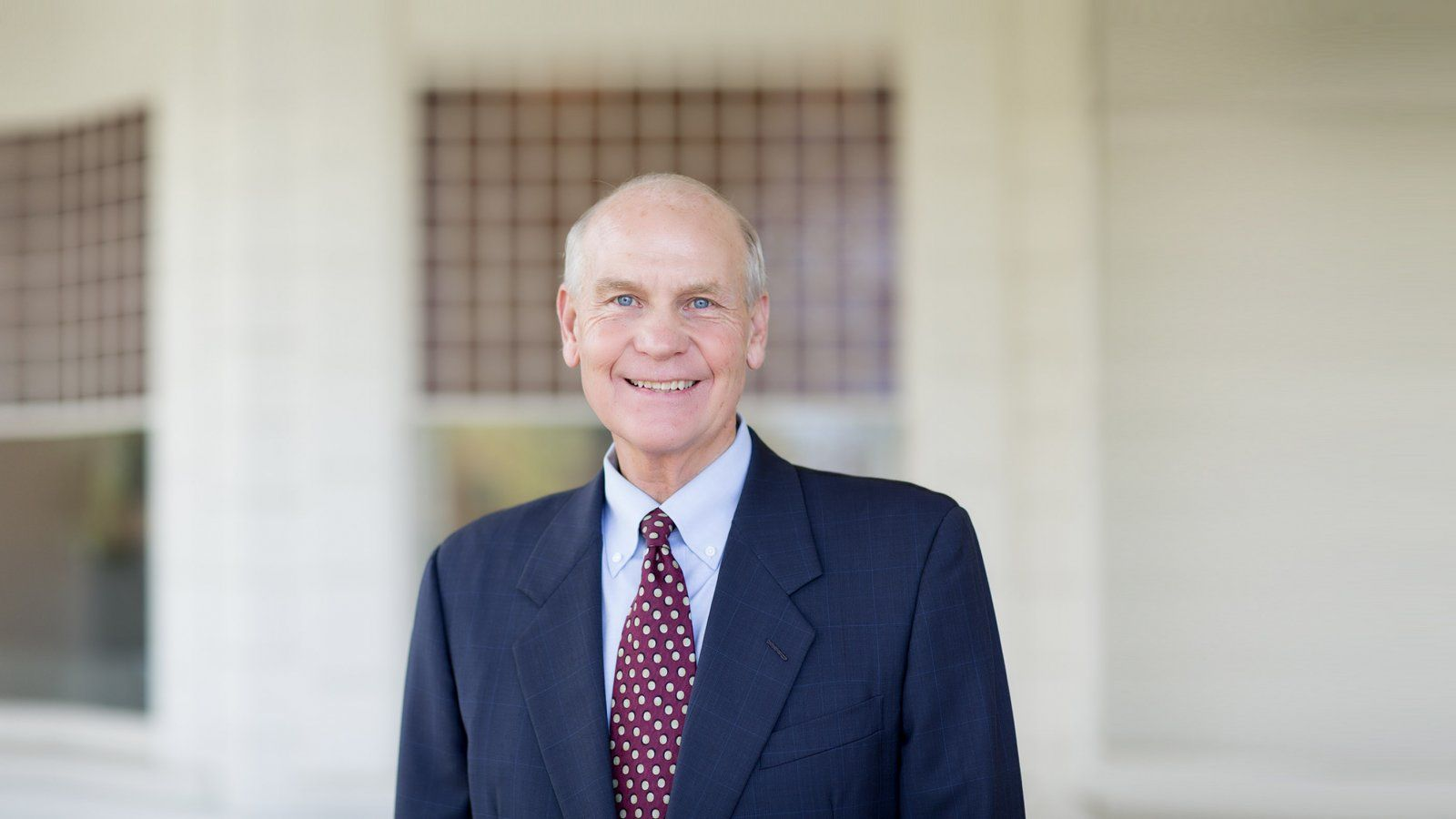 PLNU President, Dr. Brower in front of Mieras Hall