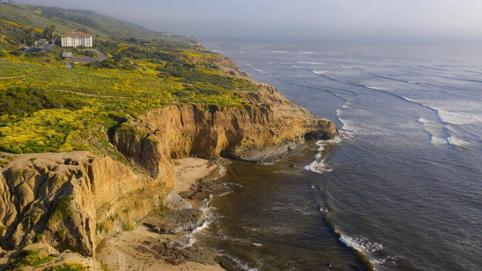 Aerial view overlooking Young Hall with the rugged coastline off the campus of PLNU