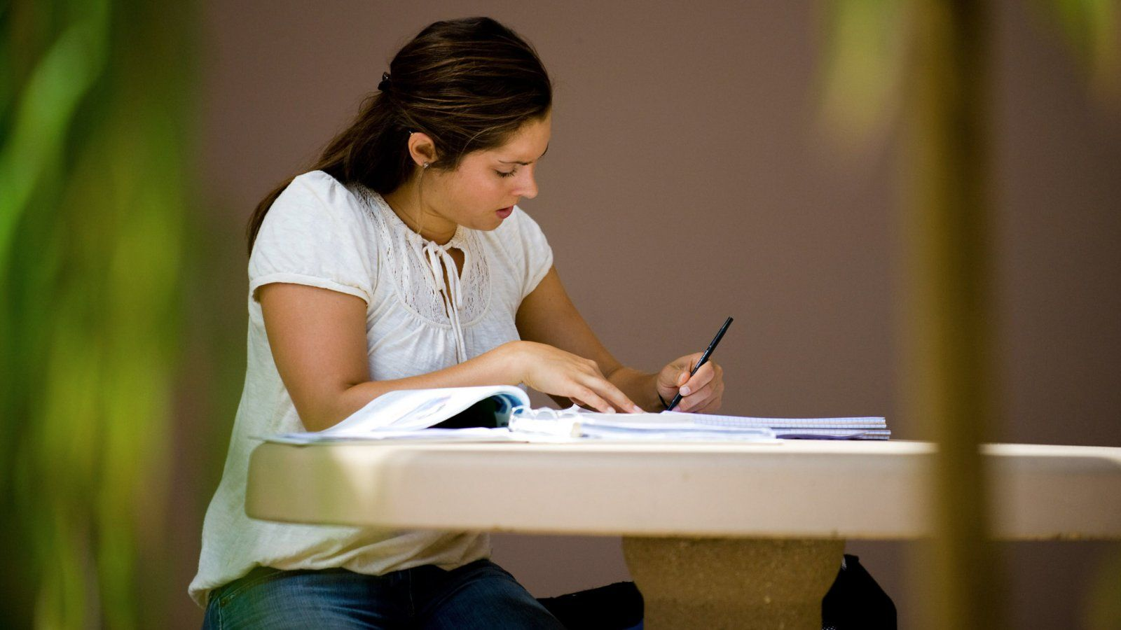 A student works on an assignment outside.