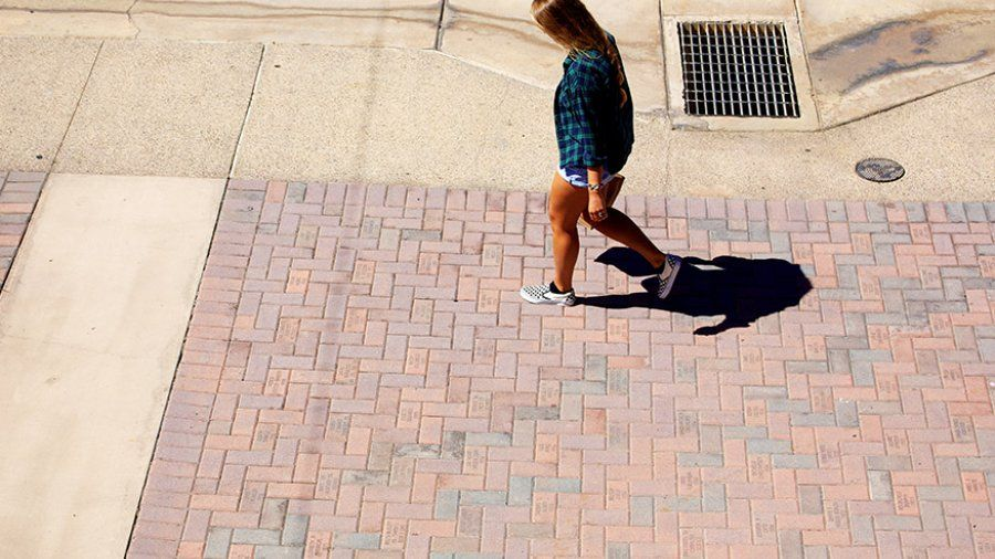 A student walks down the Campus Mall