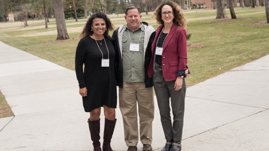Jacque Mitchell, Scott Bennett, and Paula Cronovich at conference