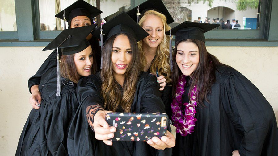 PLNU students take a selfie as they wait for commencement to begin