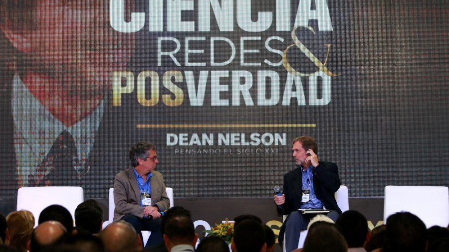 Dean Nelson speaking at a conference in Columbia