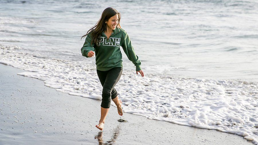 PLNU senior Katie Green runs on the beach.