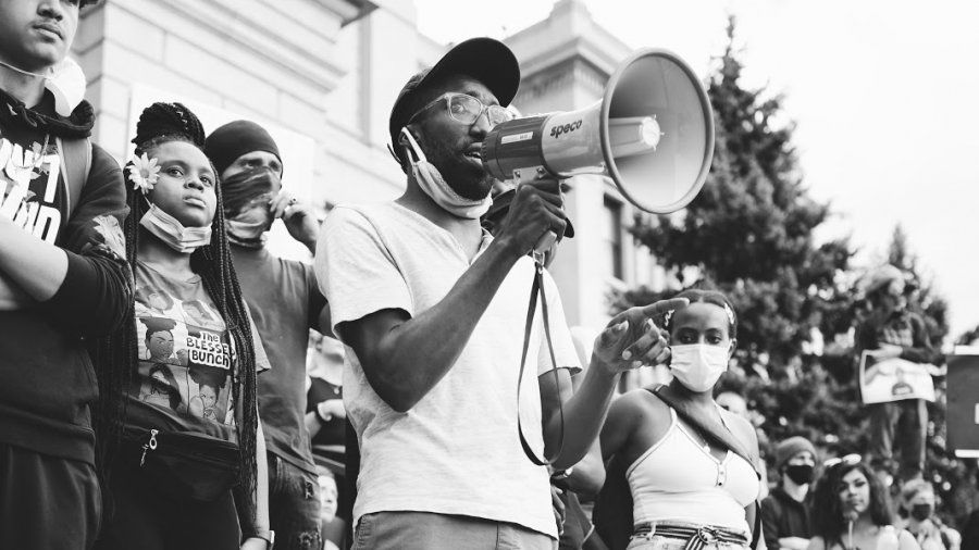 A man stands with a megaphone as part of the Black Lives Matter protests