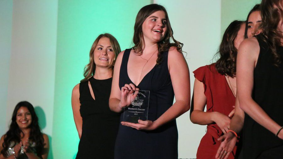 PLNU women's soccer team players receive their team award at the inaugural SLAM awards