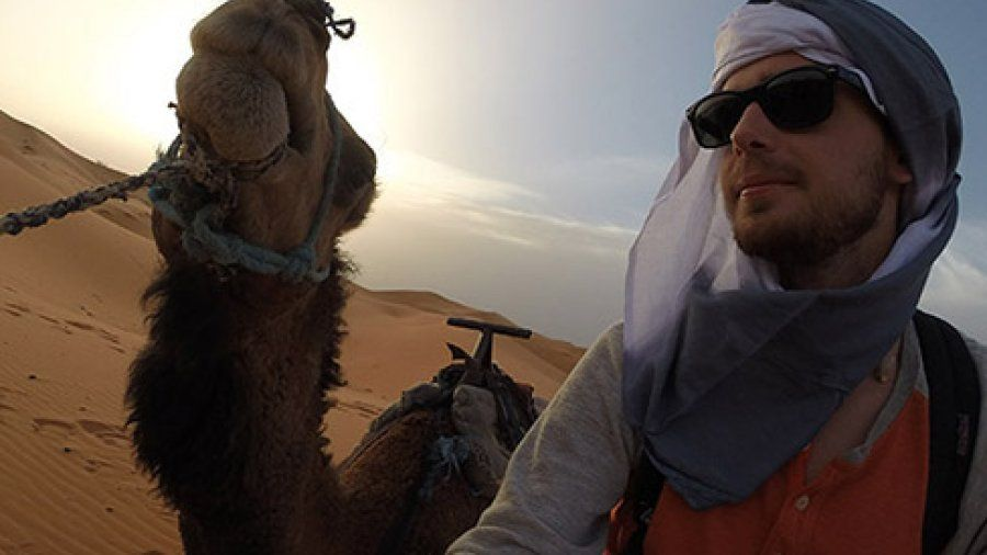 Student with a Camel Abroad