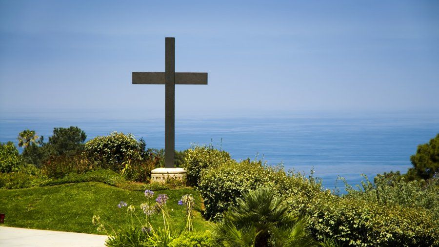 The PLNU cross overlooking the ocean.