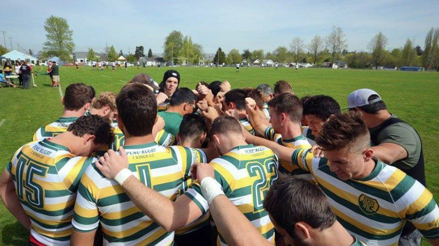 PLNU Rugby Club players gather in a huddle to pray before a match.