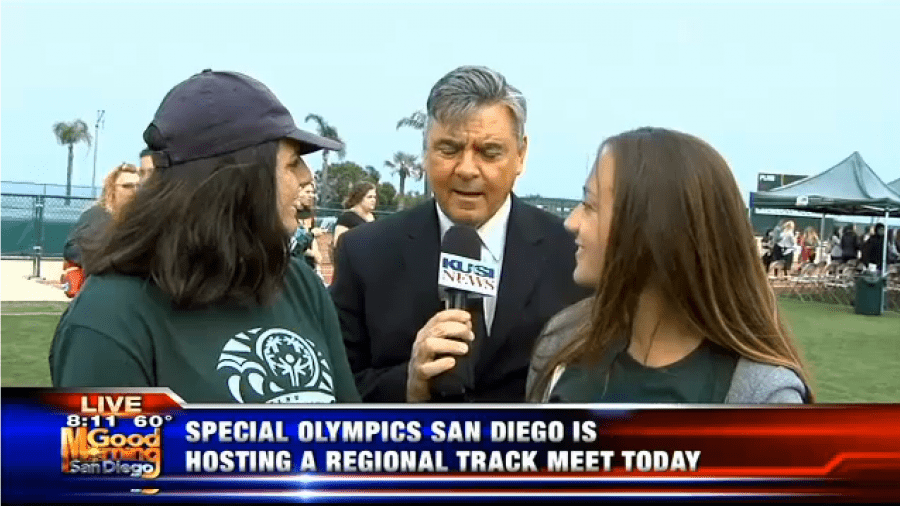 Newscaster interviewing students for Special Olympics