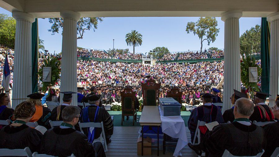 A view from the Greek Amphitheatre toward the crowd of family and friends gathering for commencement