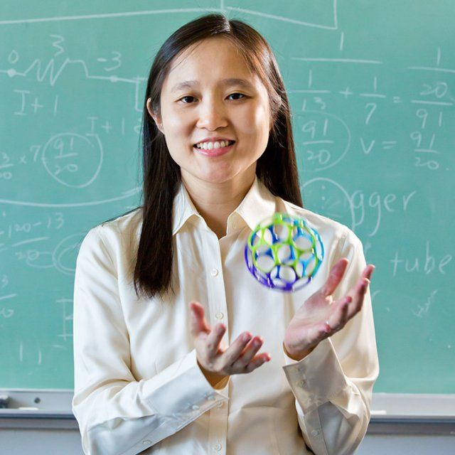 PLNU professor Michelle Chen tosses up a colorful ball while posing for a headshot