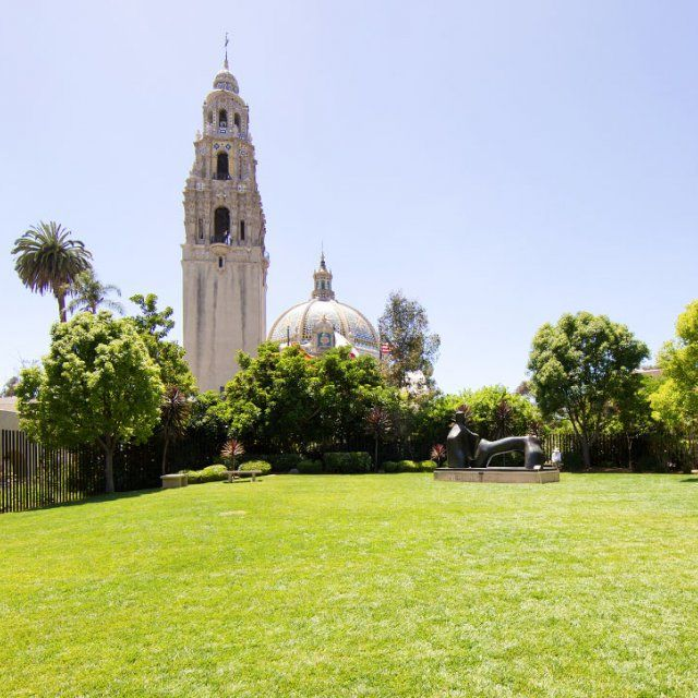 California Tower in Balboa park from a distance over a large grass lawn