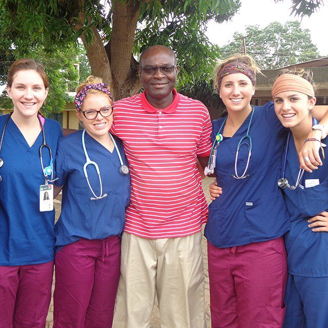 PLNU nursing students pose for a photo outside the Human Factor Leadership Academy in Ghana