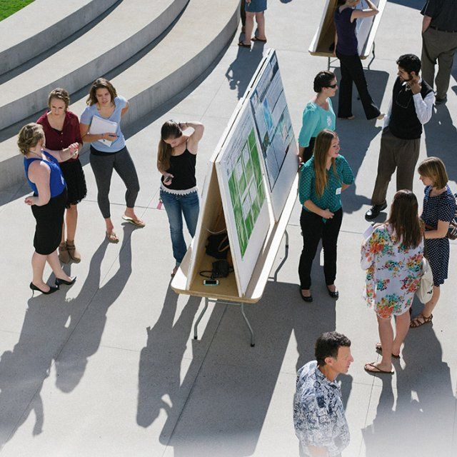 PLNU science students present their research findings on the outside plaza of Lator Hall.