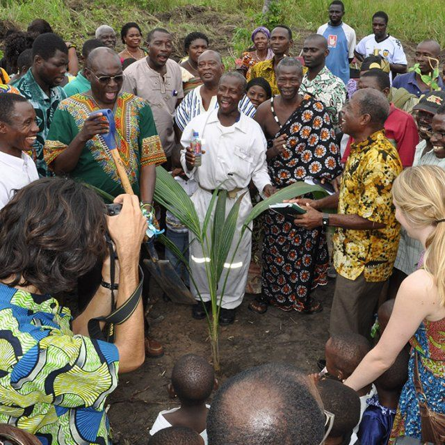 A group celebrates planting a new tree at the Human Factor Leadership Academy in Ghana.