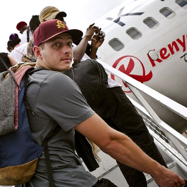 Student boards a plane for a LoveWorks mission trip.