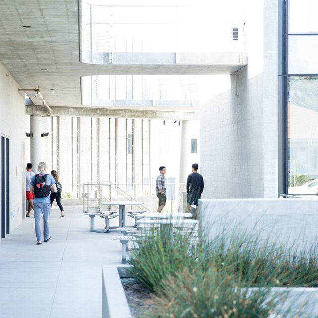 Students walk into the science building on PLNU's campus.