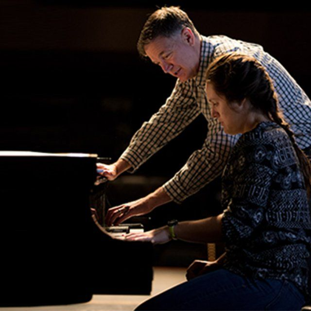 Sarah Victor gets piano lessons from Professor Victor Labenske