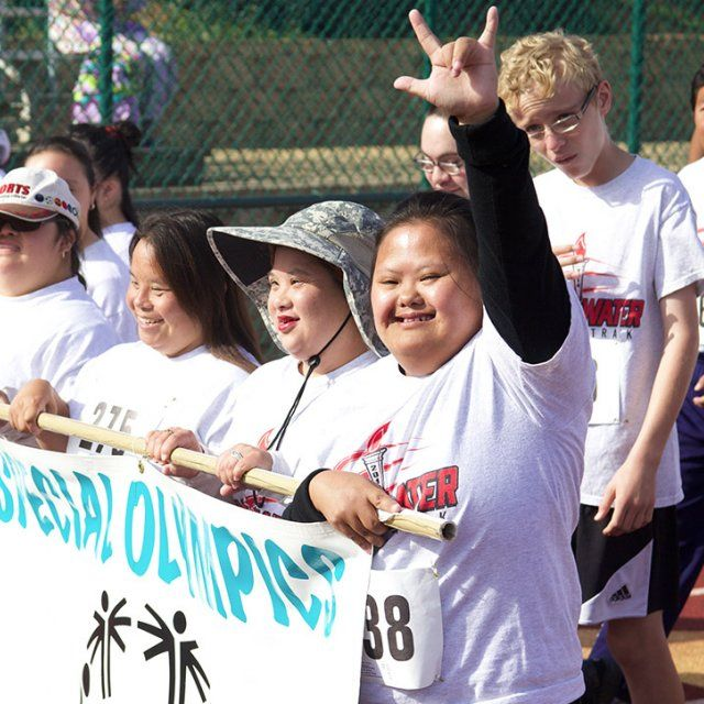 Athletes march in the opening ceremony of the Special Olympics at the PLNU track and field in San Diego