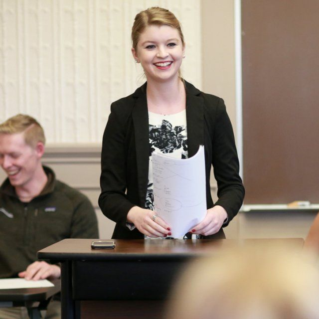 A student stands ready for a speech and debate tournament.