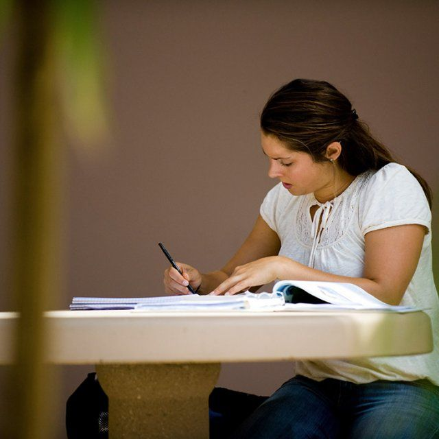 A student works on homework outside
