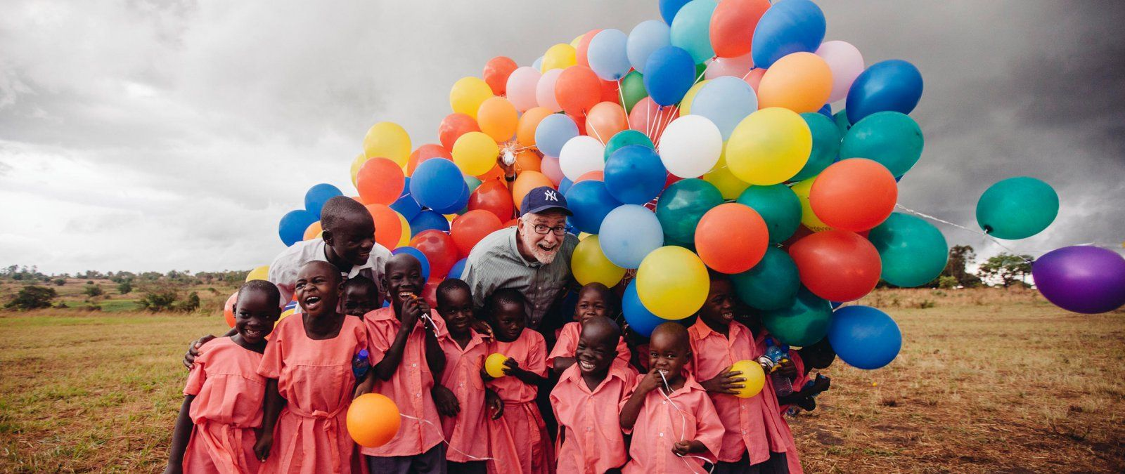 Bob Goff brings a large collection of colorful balloons to his Love Does students in Uganda