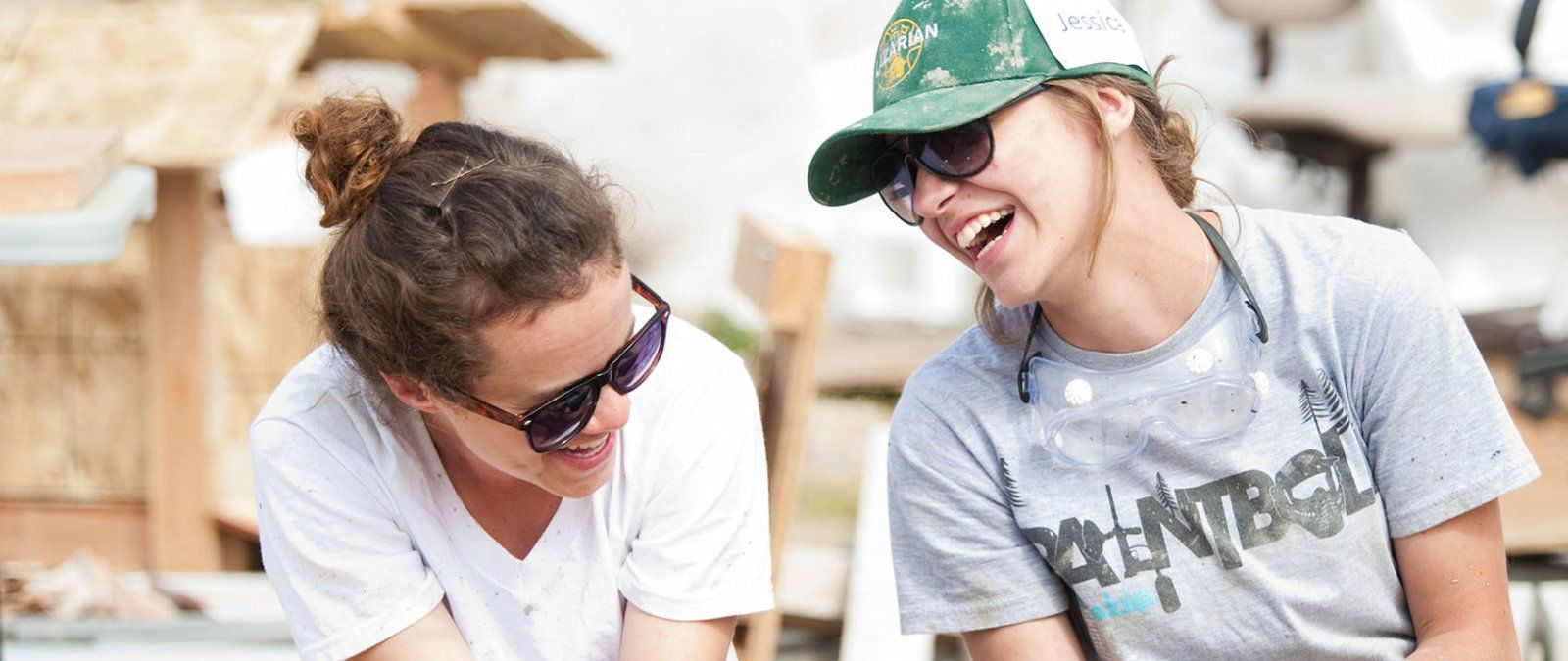 Two female PLNU students take a break to talk and relax during a homebuilding project in Mexico with La Iglesia ministries