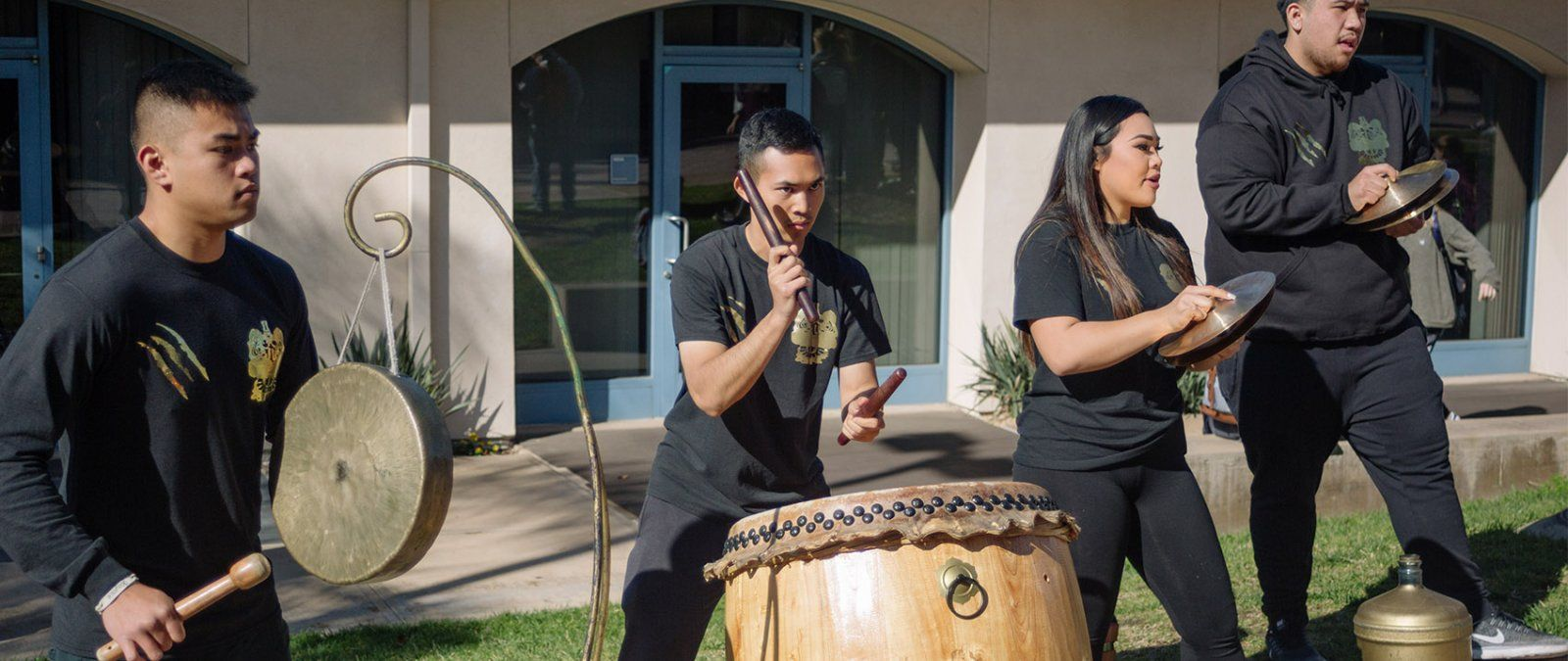 The Asian Student Union club performs with drums and cymbals on the Campus Mall