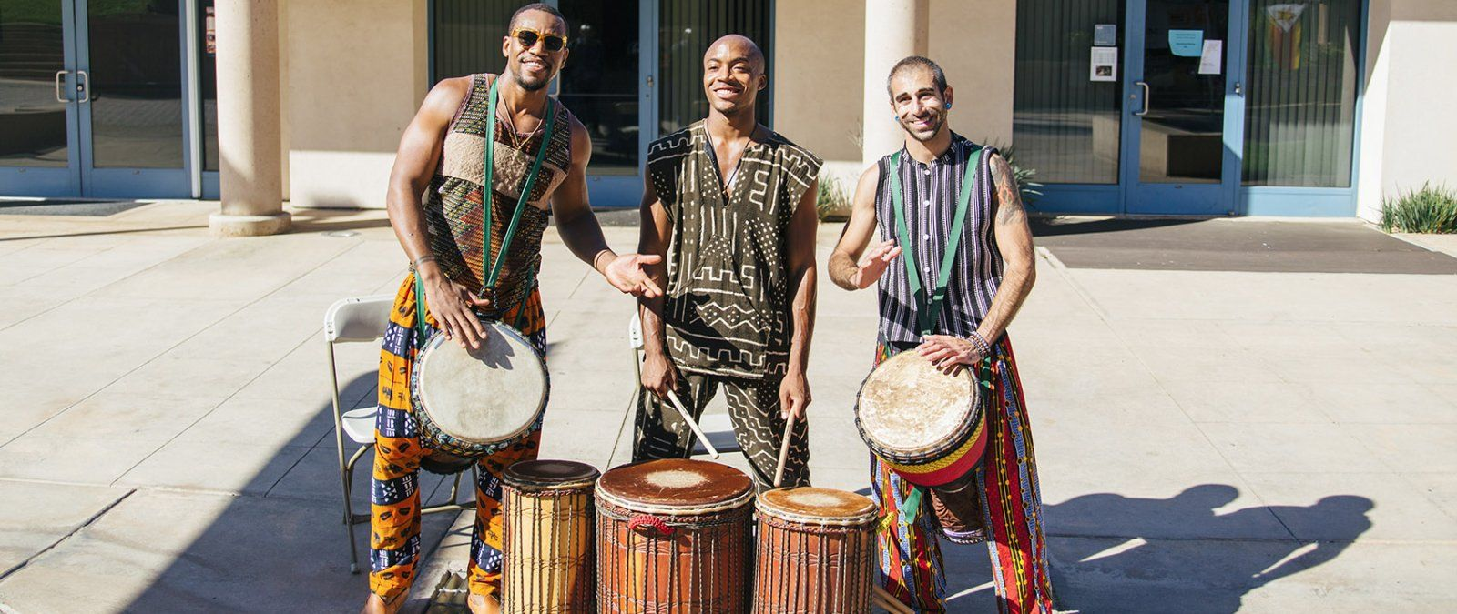 At a Tribute to Africa event, students play traditional drums and celebrate African cultures.