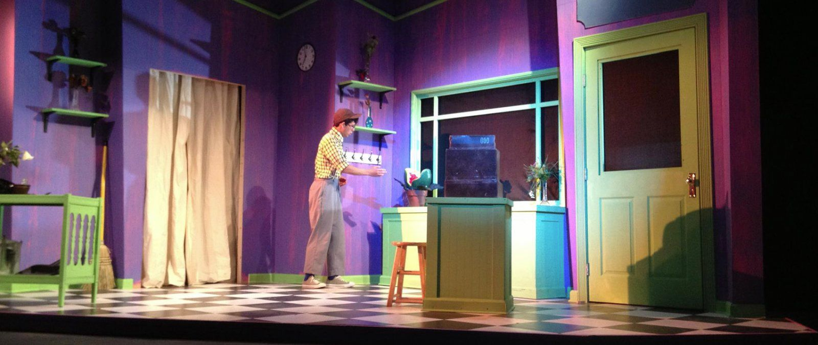 Male actor cautiously approaching sink while acting in Little Shop of Horrors
