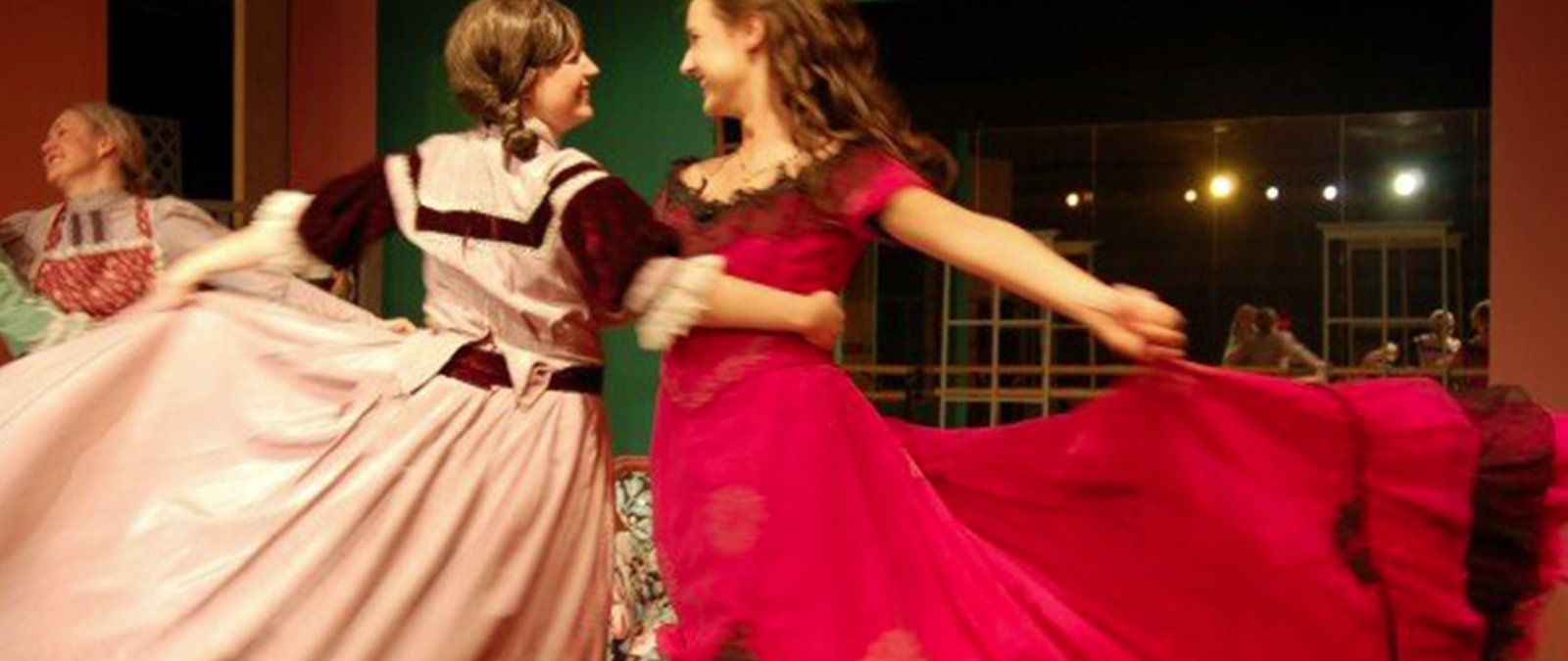 "Two actresses dancing joyfully while acting in ""Little Women"""