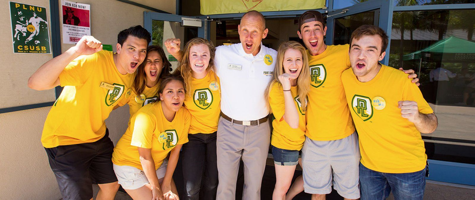 A group of students and Nick Wolf, director of programs and operations, greet incoming students at NSO.