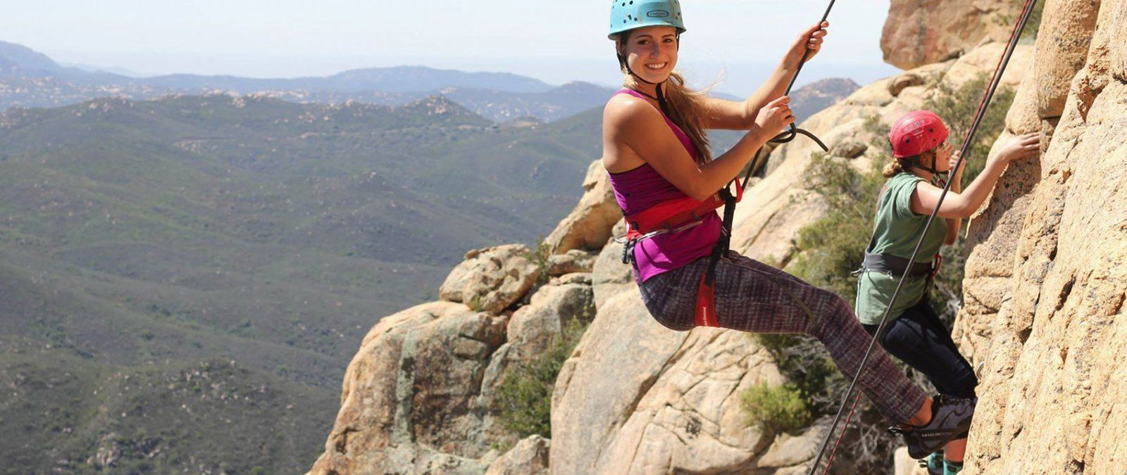 A student climbs Descanso Wall during a Great Escapes rock climbing trip.