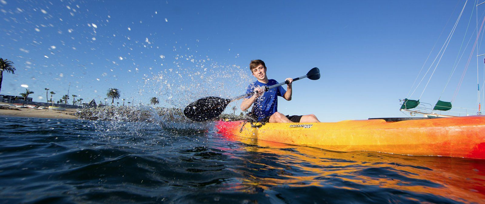 A student kayaks in the San Diego Bay.