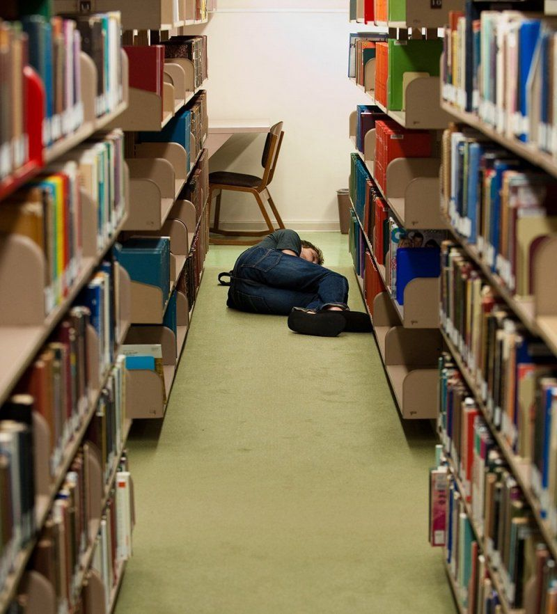 Student asleep in library