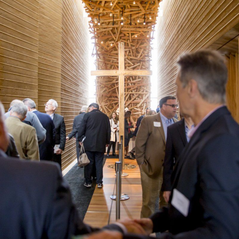 A large group tours the Prescott Prayer Chapel during its grand opening.